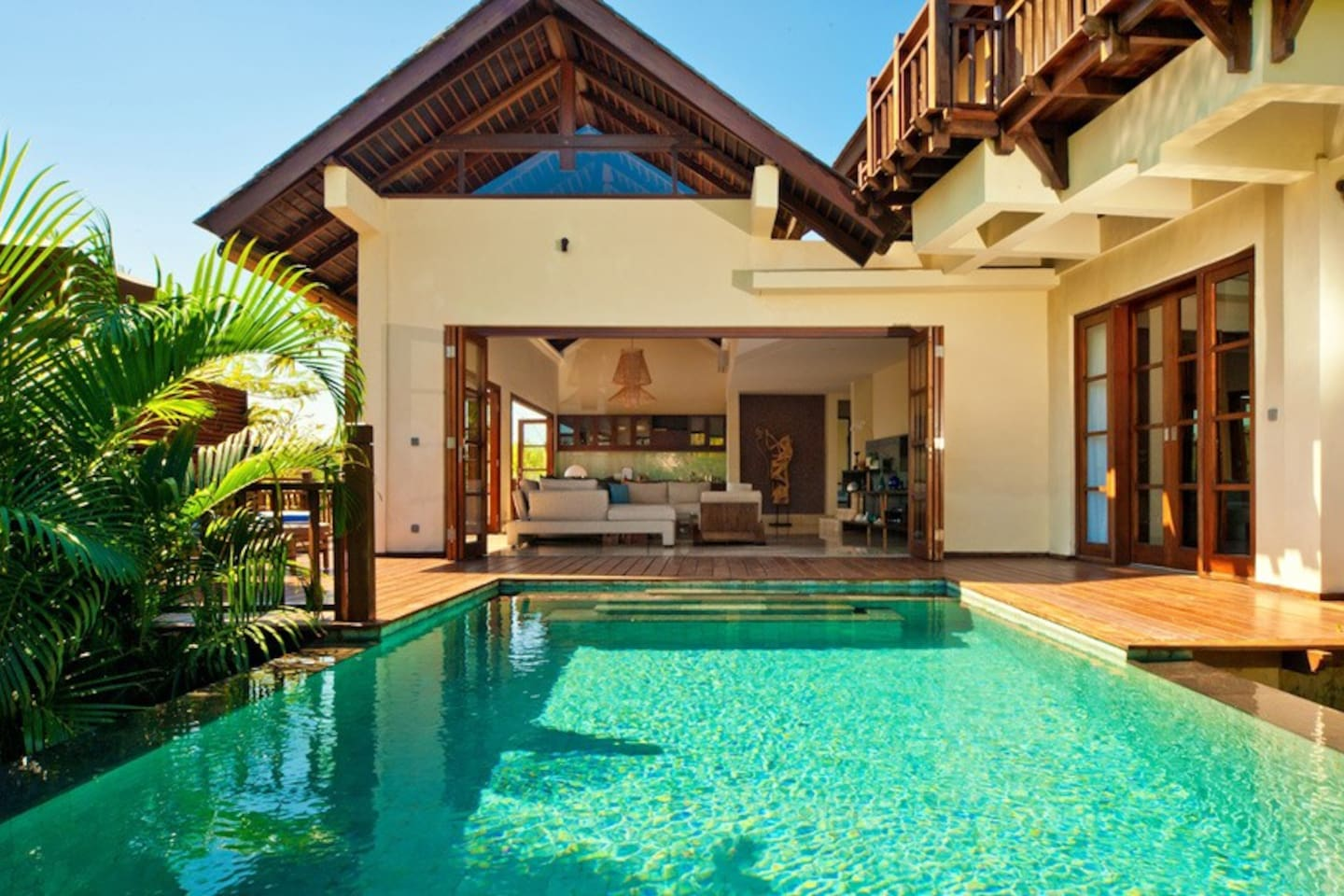 Villa Karma Manis' private pool with surrounded wooden deck