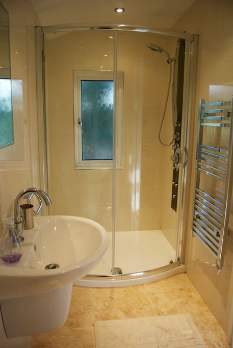 The en-suite complete with heated towel rail and walk-in shower