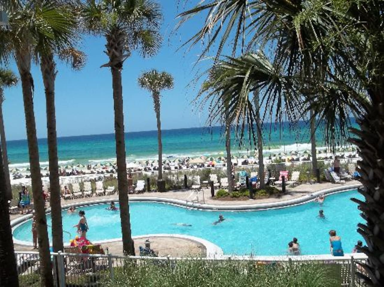 View of the beachfront pool.  There is also a hot tub and tiki bar on this deck.`