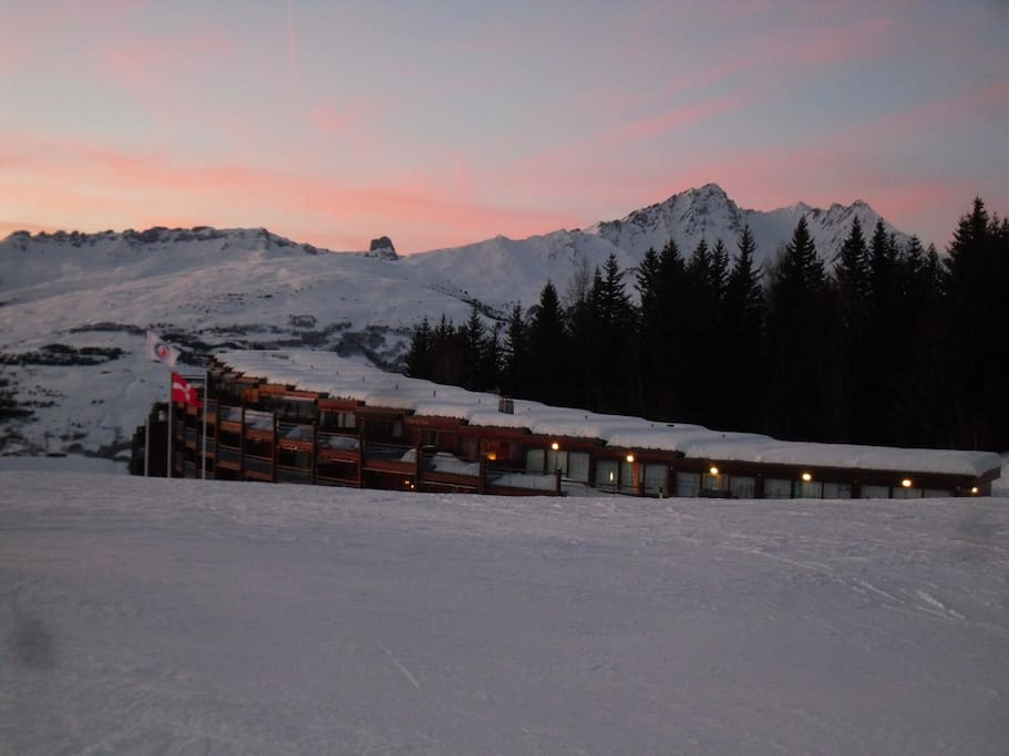 Sunset over my apartment block- photo taken from adjoining nursery slope (chairlifts either side).