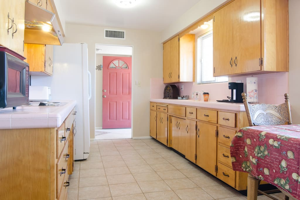 Dishes, pots, pans, microwave, coffee pot, toaster, and electric stove, it's all here.
