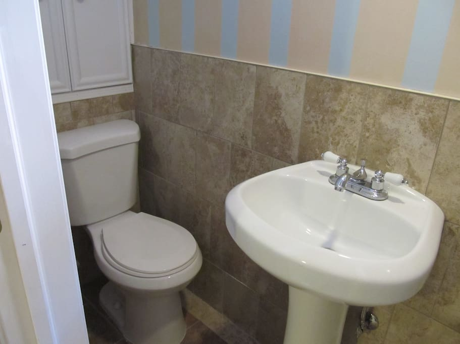 Toilet and sink in private bathroom