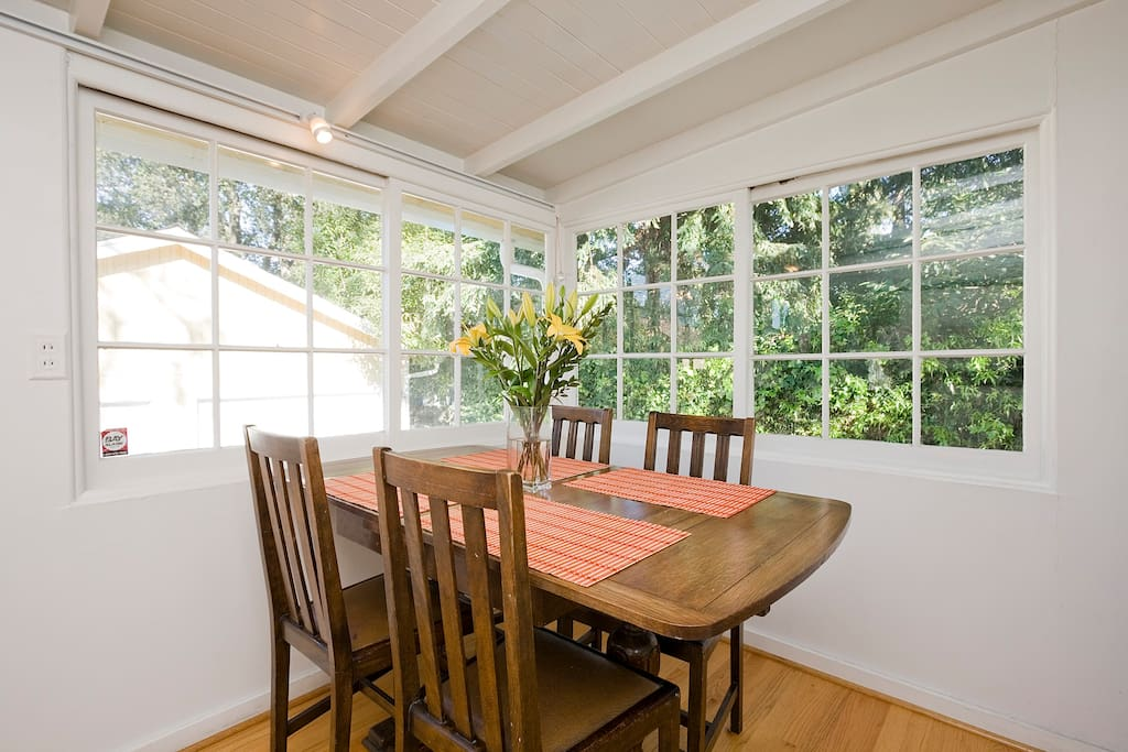 The kitchen table overlooks the garden in the back of the house.