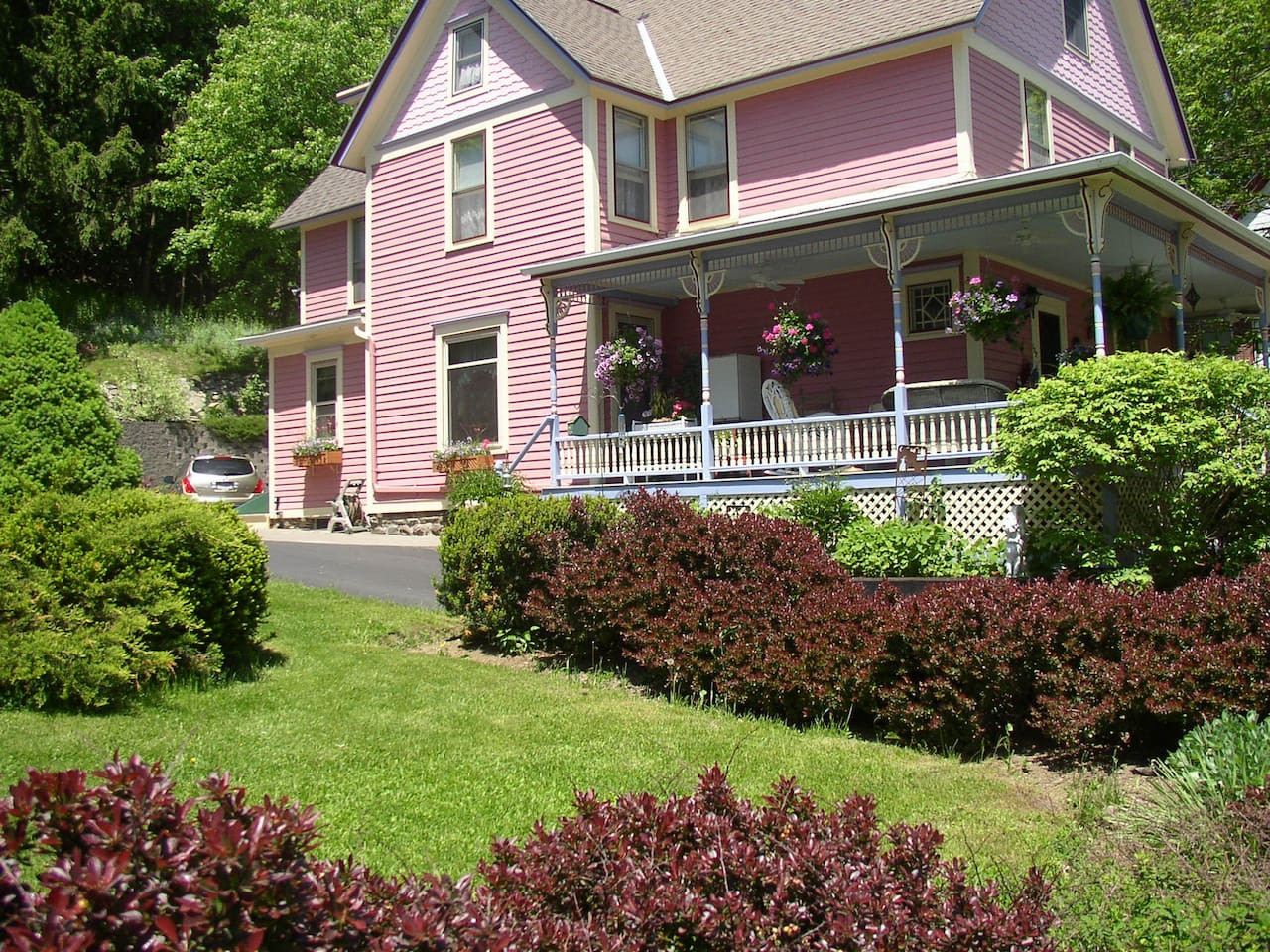 Relax on the wraparound porch of The Rose and Thistle Bed and Breakfast