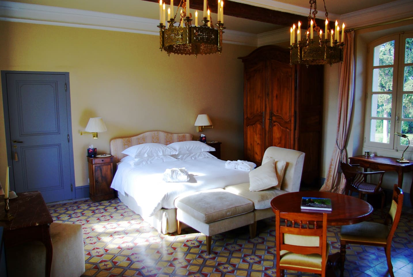 Autan - our most spacious guest room with large double bed, ensuite bathroom and views over both sides of the domaine.