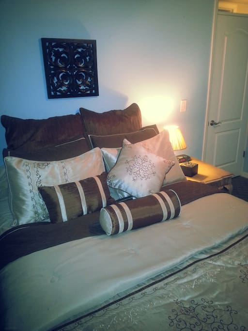 Comfy bed in spacious room with Bathroom just across the hall
