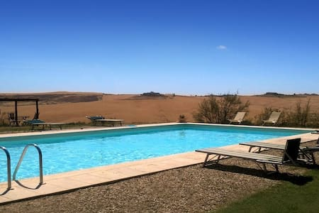 A historic farm in the Crete Senesi