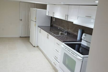 Fully equipped basement apartment - House
