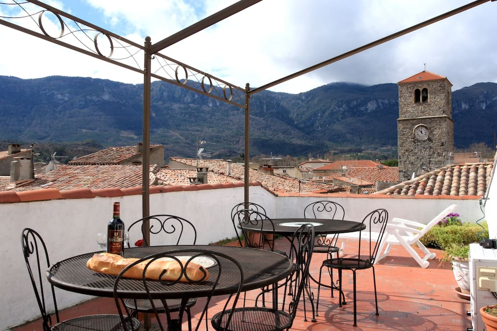 roof terrace with view of the roofs and mountains