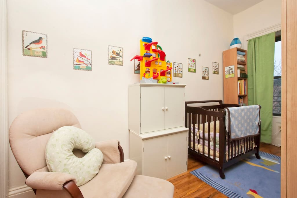 Kid's room -- great for a toddler, could possibly fit two kids (snugly). The cabinets are full of toys!