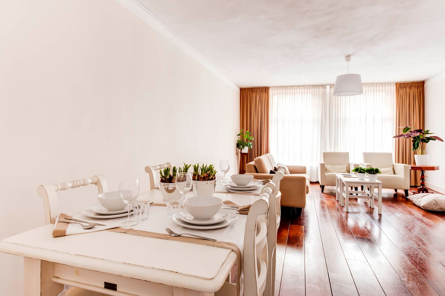 Dining table for four and comfortable living room.
