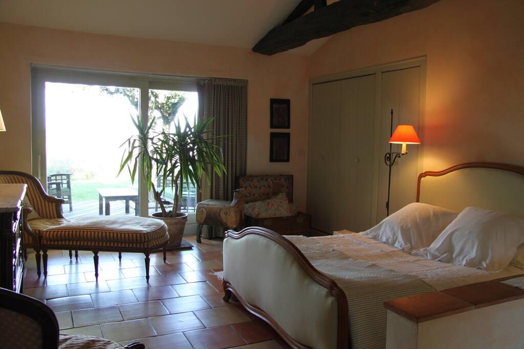 main floor terrace room 40m² (430ft²) with queen size bed