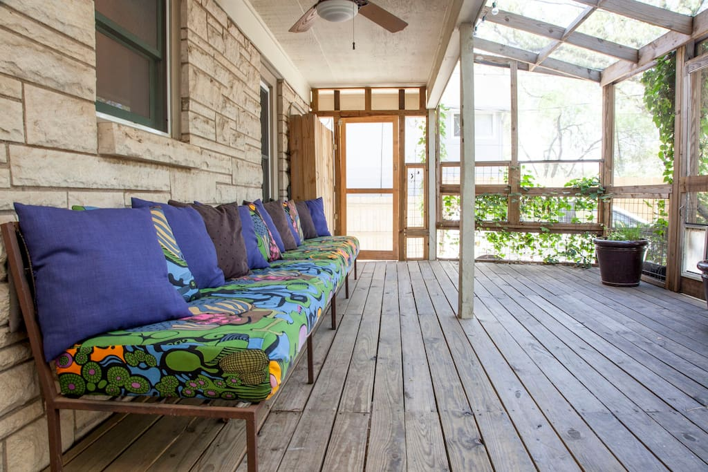 Two long outdoor couches for relaxing or napping on lazy afternoons.
