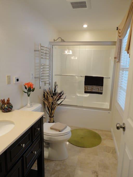 Spacious bathroom with towel warmer and heated floor :)