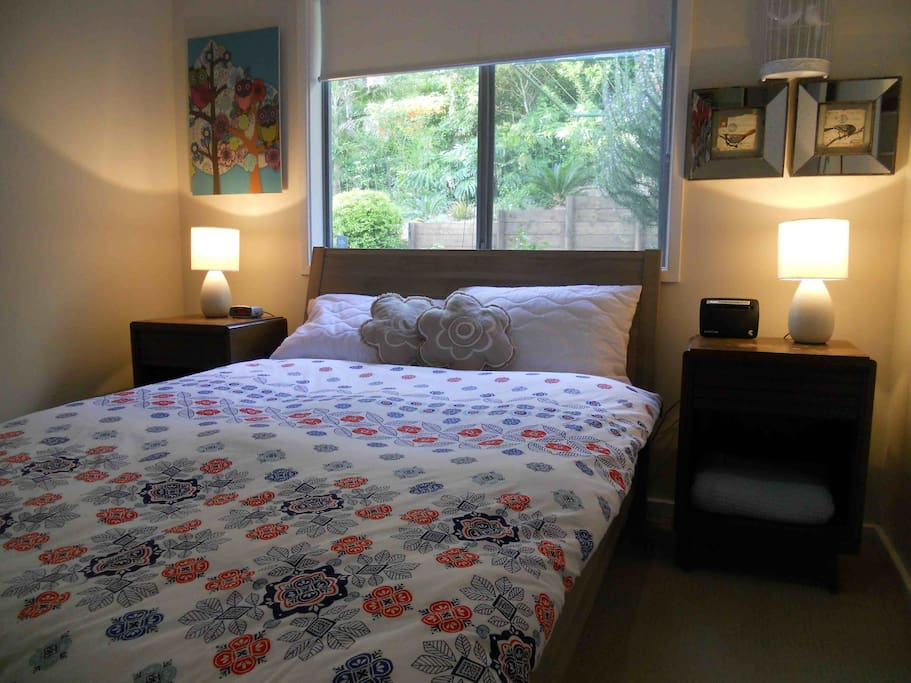 Second bedroom features full sized bed