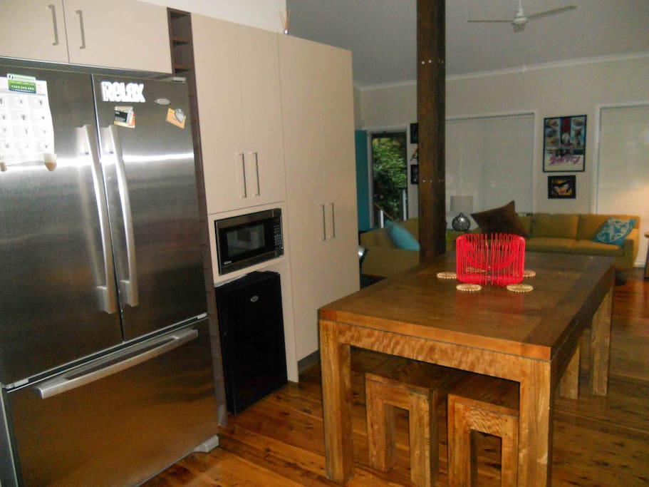 Dine-in kitchen with large French-door fridge