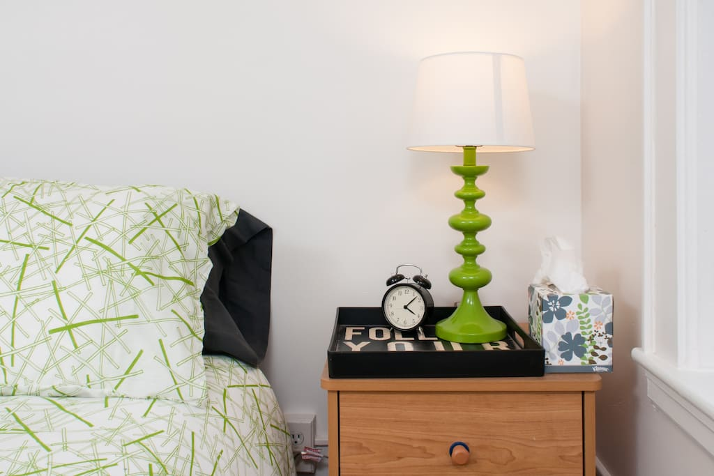 Working alarm clock and lamp on the night stand