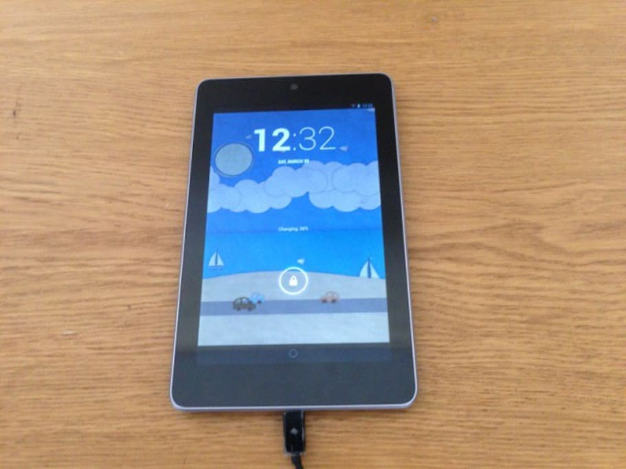 """Nexus 7"""" tablet preloaded with apps like HBO Go so you can watch movies in the comfort of your room"""