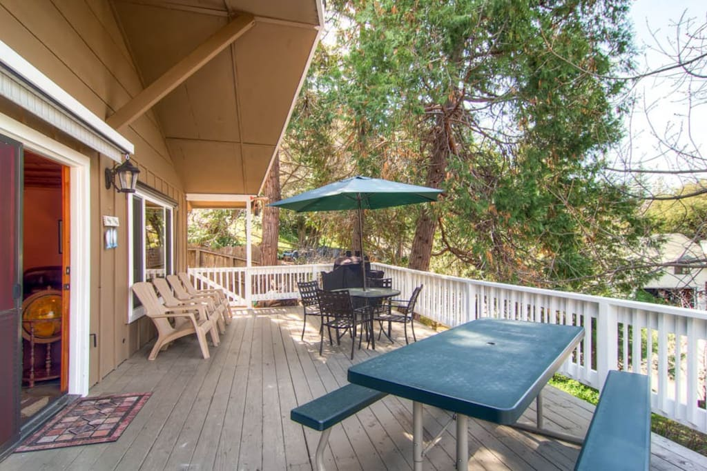 Large enclosed deck with picnic table and BBQ with propane provided