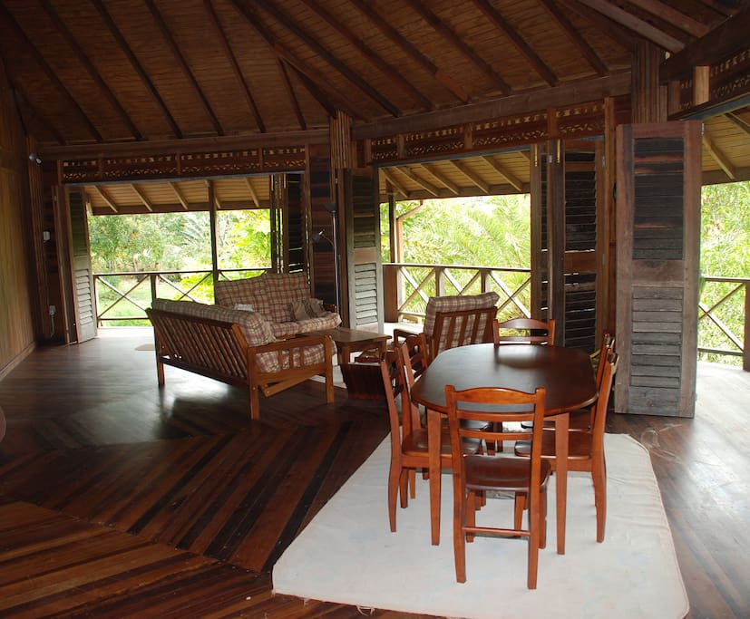 The main living area with wooden doors open.