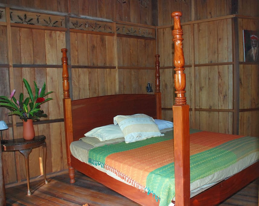 Master bedroom with king size mahogany bed.