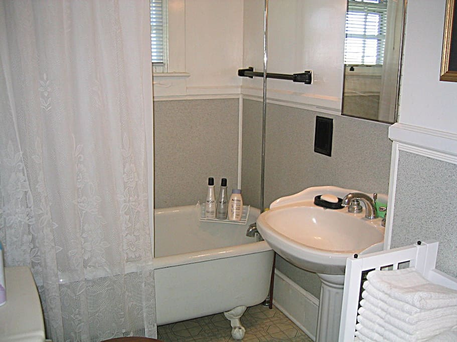 Charming bath with claw foot tub with shower