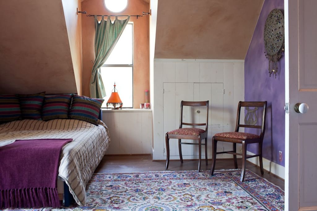 The music room, an upstairs bedroom, complete with a spacious balcony.