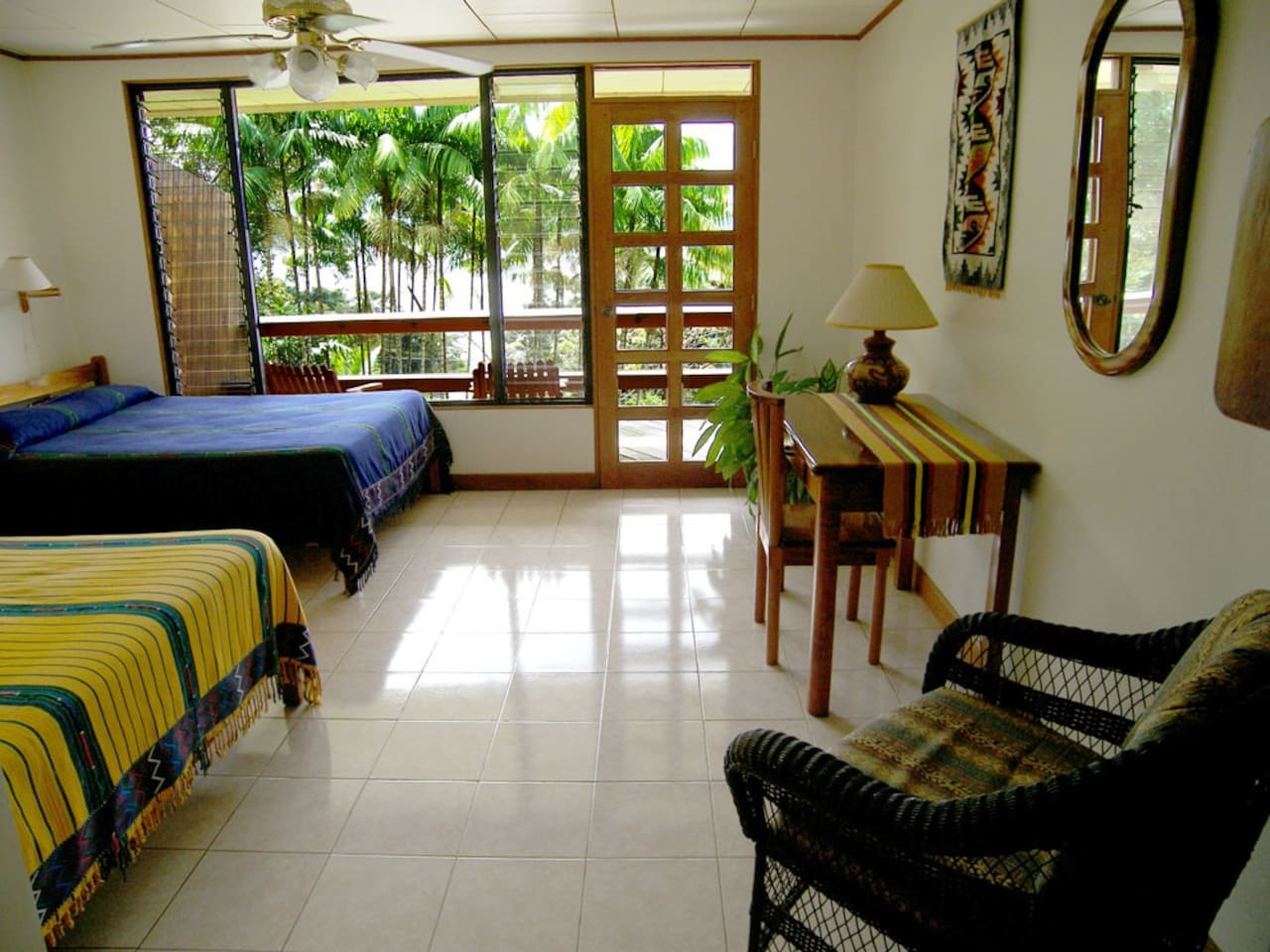 2 beds (1 queen, 1 double), private entrance, private bathroom, private balcony with excellent views of Lake Arenal