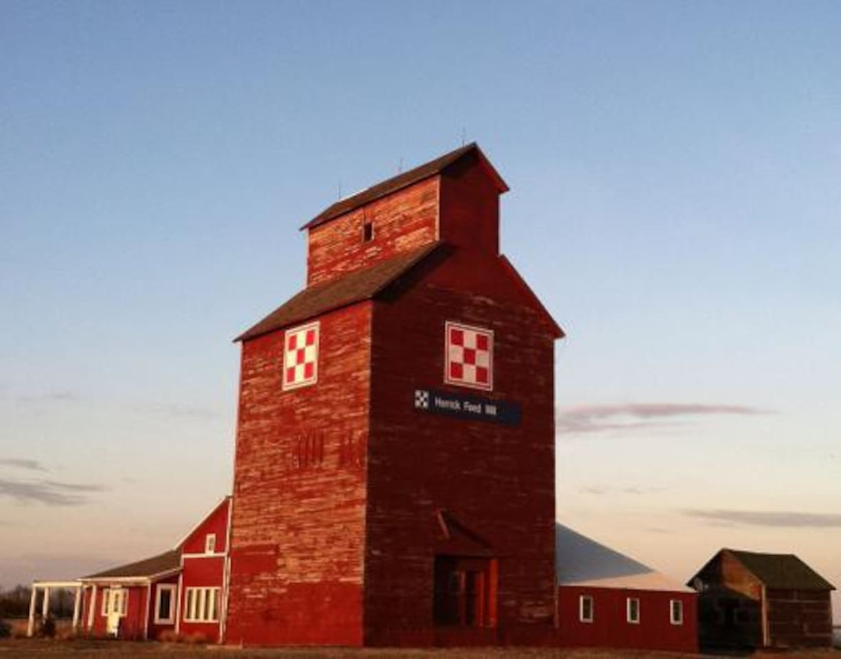 Antique wooden grain elevator, built in 1907.  Gift shop is in the old scale house at left.