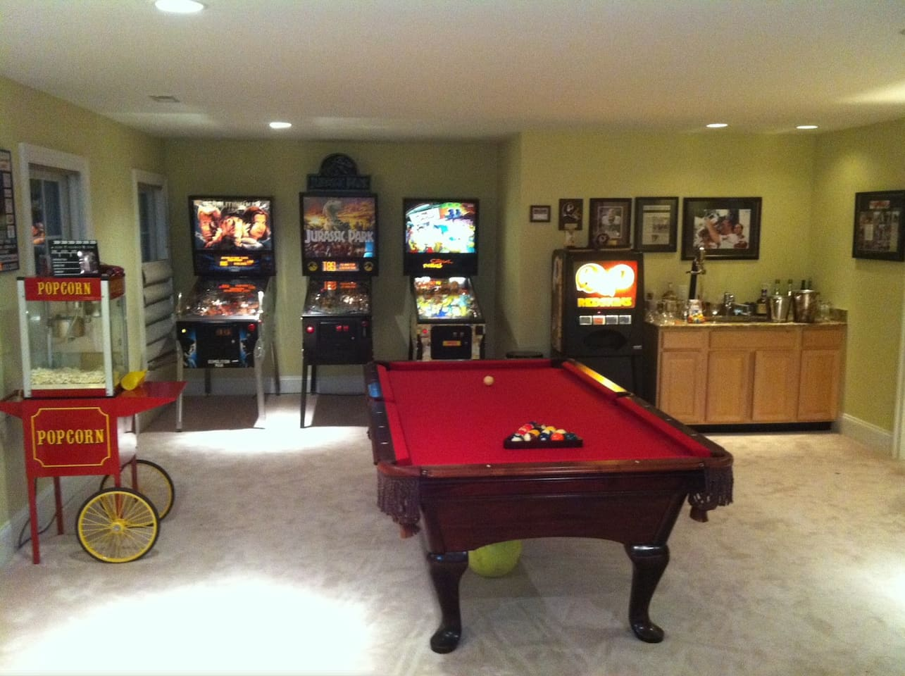 Located down stairs our Entertainment room is AWESOME! Popcorn Machine is self explanatory. Pinballs are complimentary and require no money.  Play pool, watch TV or Dance the night away.  We also have a fun disco party light & rockin sound system!