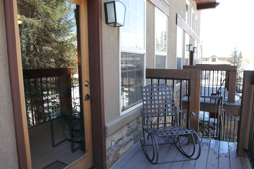 Back deck with access to hot tub.