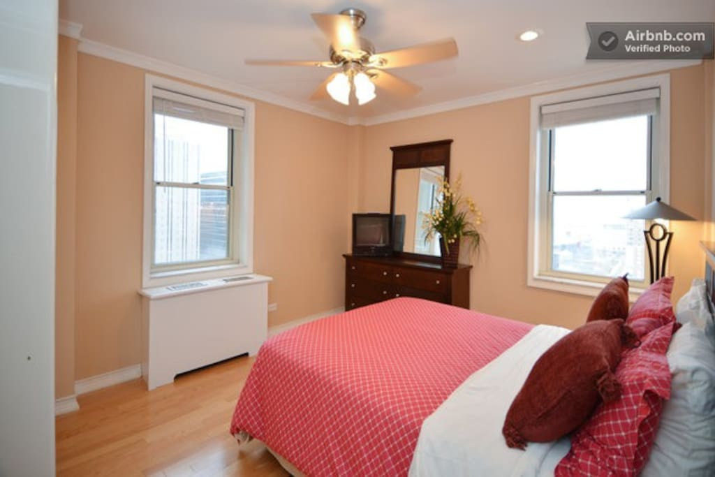 Bedroom with queen bed, dresser and great view of the World of Coke and the Georgia Aquarium