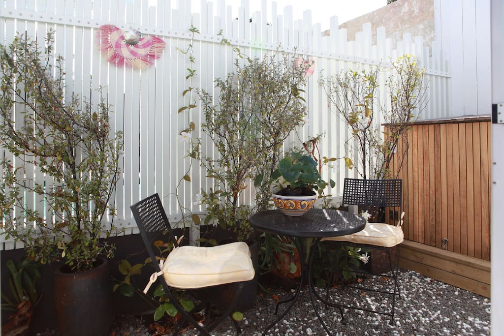 Your private, sunny outdoor courtyard with chairs & table.