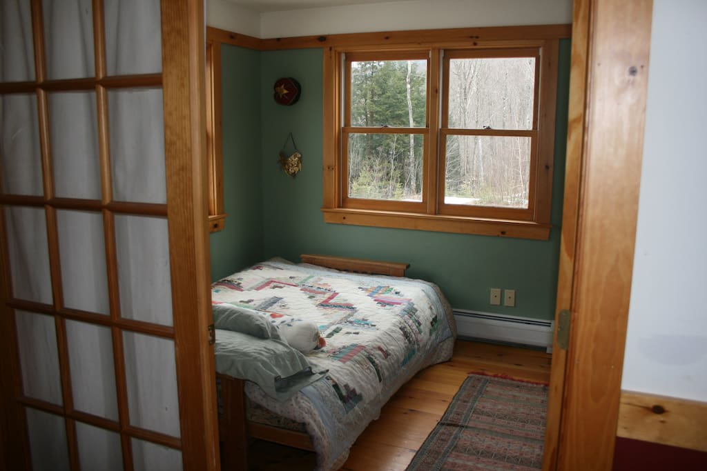 Adjacent bedroom to sitting room, double bed. Mountain views in winter with no leaves.