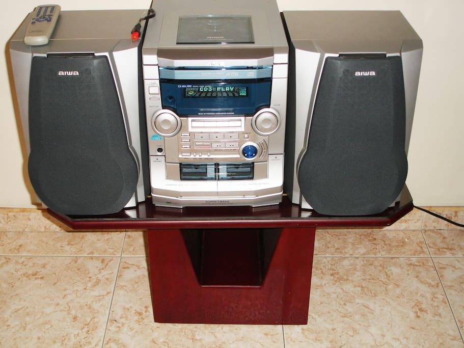 Stereo with tape and multiple CD/MP3 player.