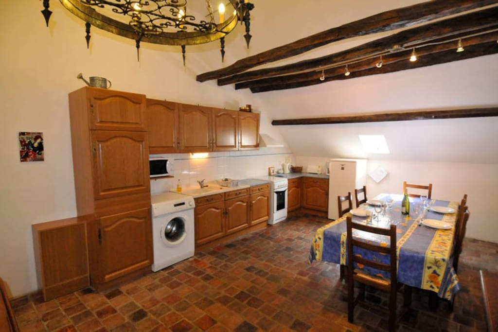 Lucarne Suite  kitchen and eating area.