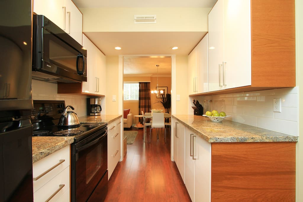 A chef's delight!  High-end cabinetry, gorgeous granite, and everything you'd ever need!