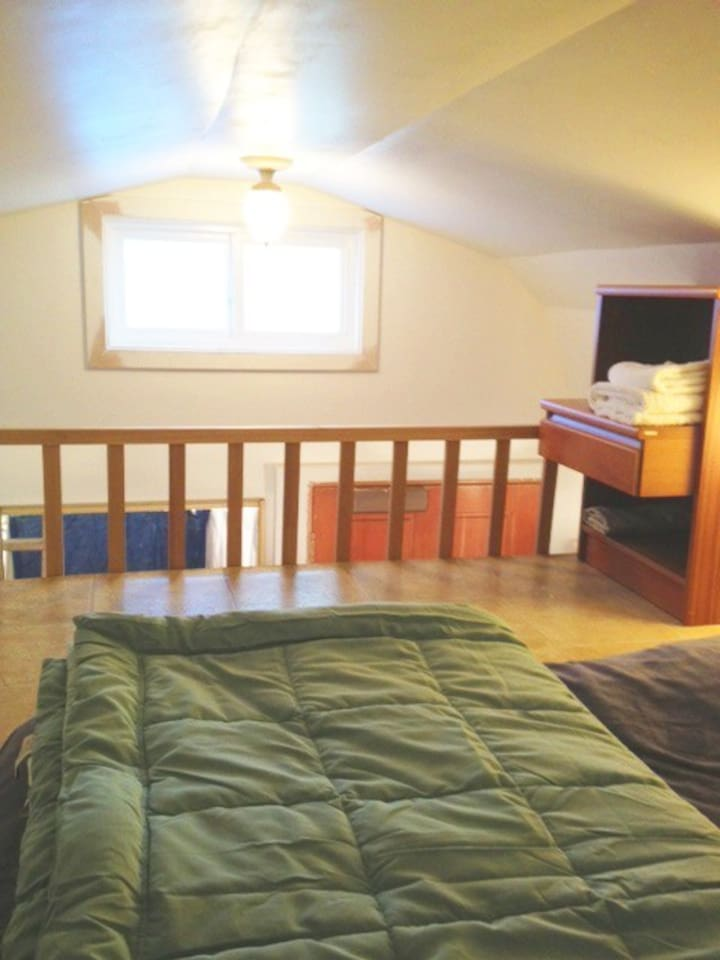 Queen size mattress up top in the loft, nightstand, lamp and of course, linens, blankets, and towels, etc.