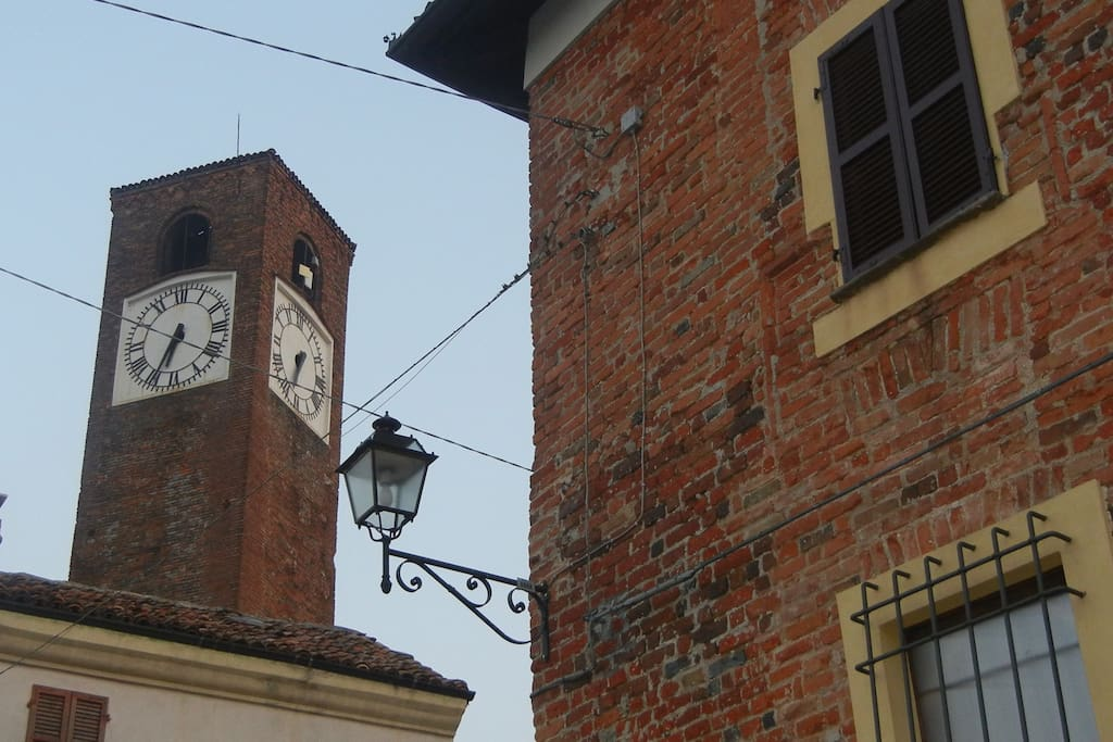 The clock tower and medieval building in the heart of Mombaruzzo