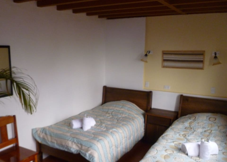 Two single beds in the big bungalow´s second floor.