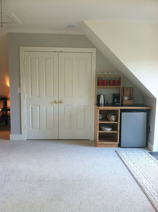 A generous closet with ample room to hang clothes! Coffee maker, electric kettle, microwave, small fridge and more...