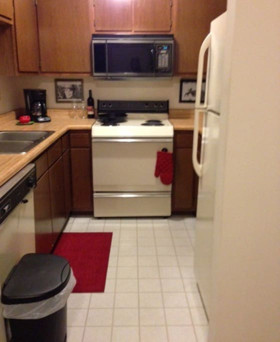 Apartment galley kitchen is small but you'll have everything you need: oven/stove, fridge, dishwasher, microwave, coffee maker/coffee bean grinder.