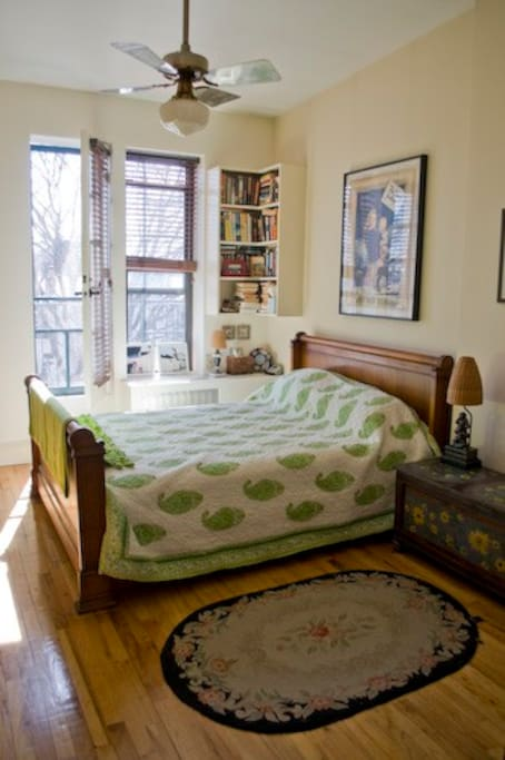 Large sunny bedroom with queen size bed