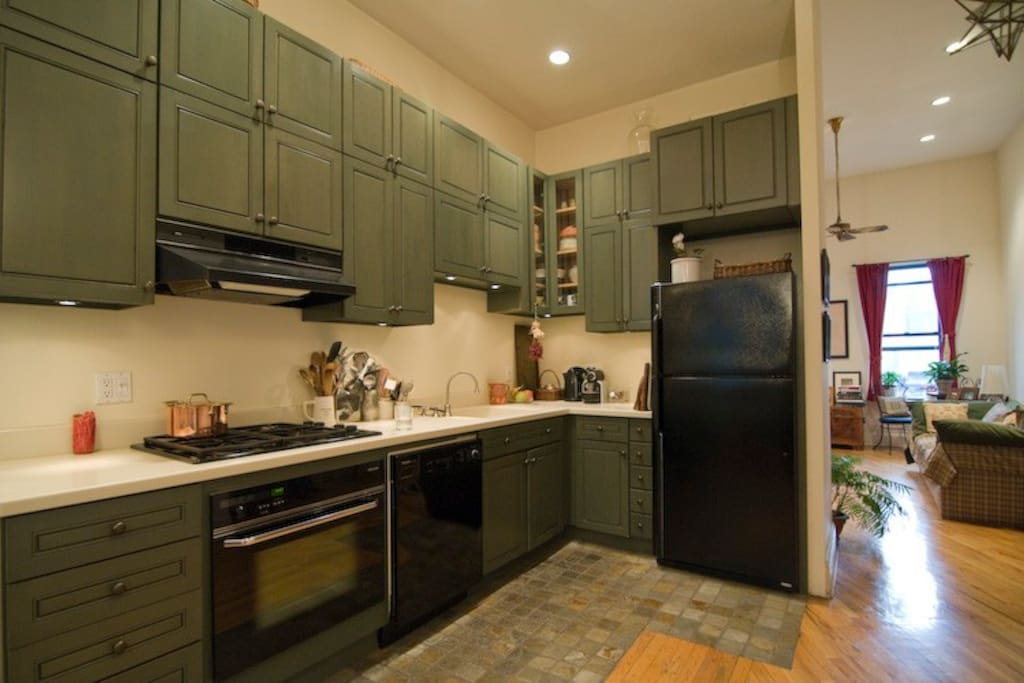 Large open space kitchen with top of the line appliances. Fully equipped.