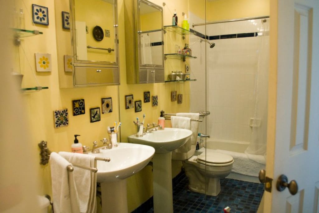 Tiled bathroom with full bath and shower