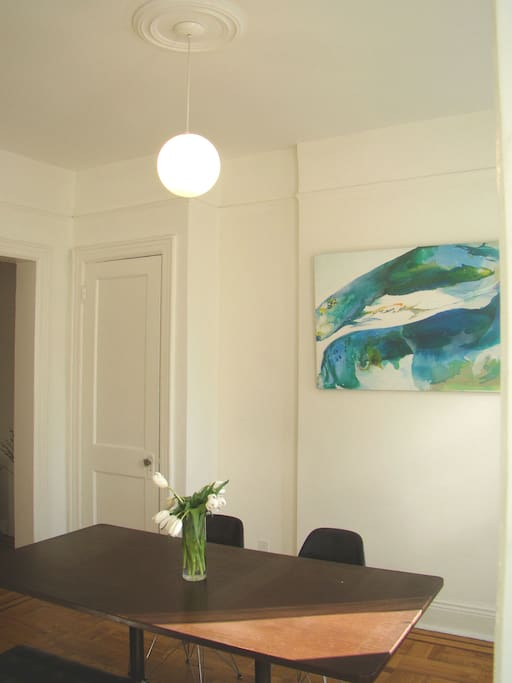 Original modern artwork graces the dining room