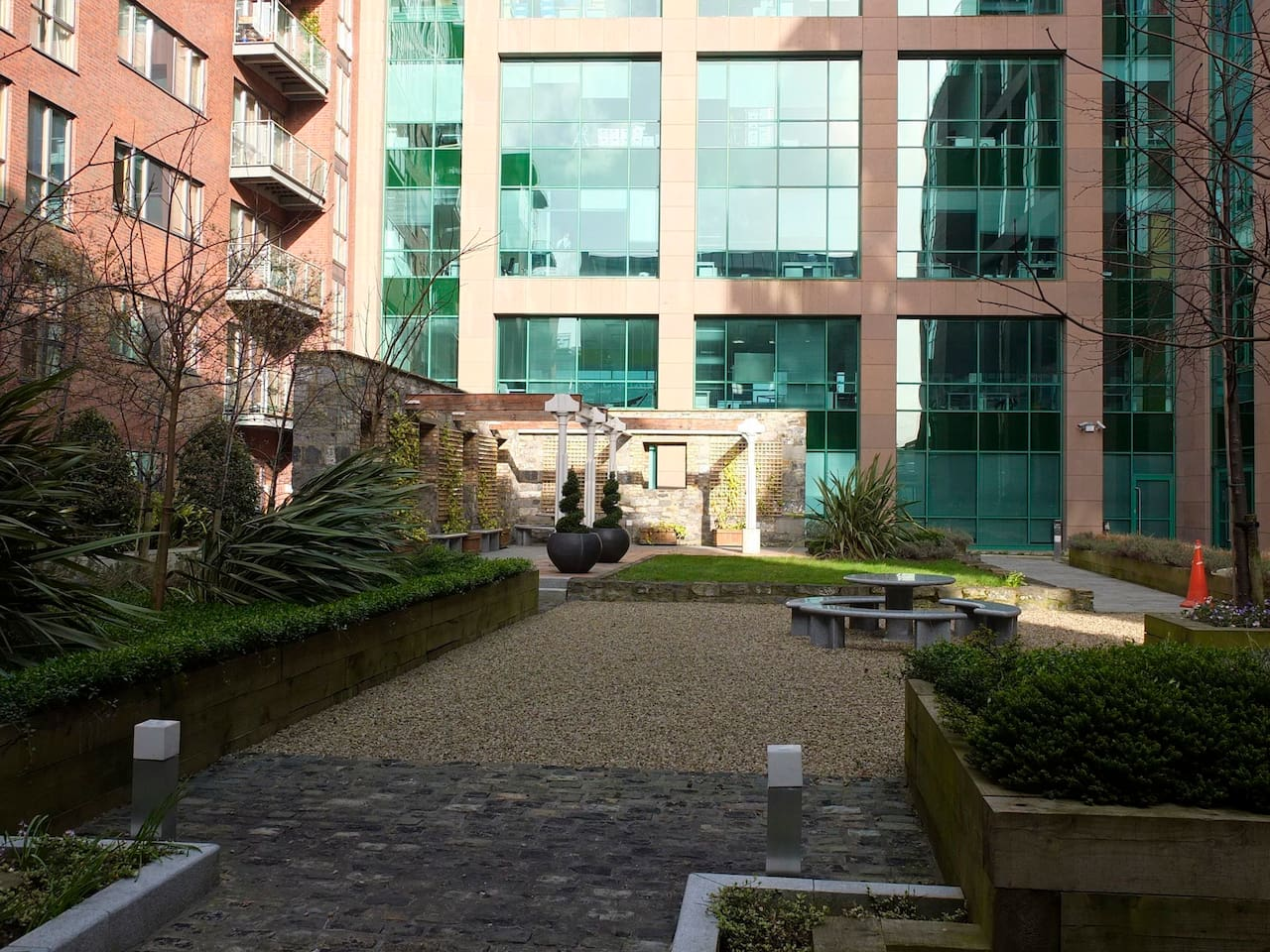 Courtyard in light - apartment building on the left, (SENSITIVE CONTENTS HIDDEN) offices on the right