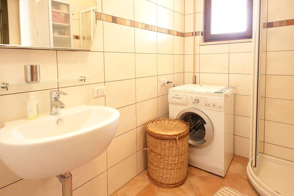 The bathroom with washing machine