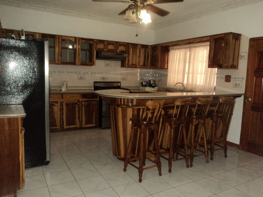 Spacious kitchen with washroom right next to it
