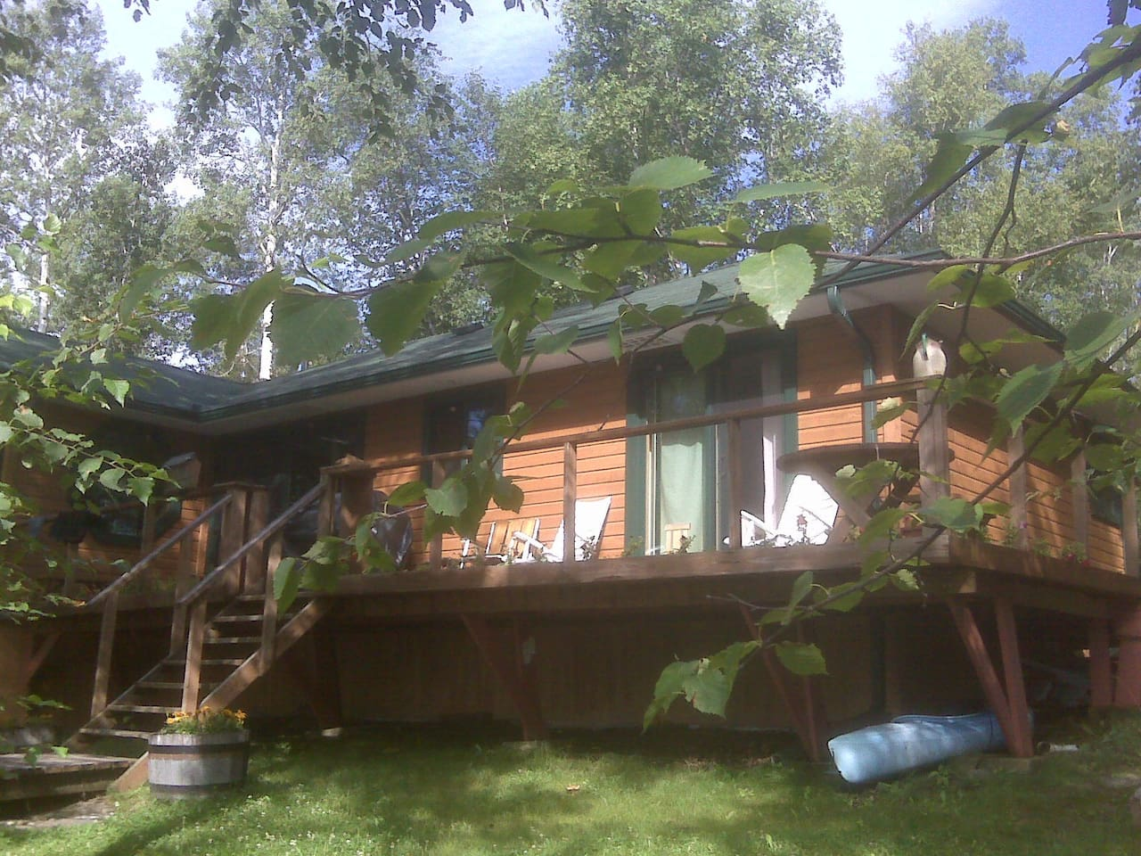 The deck, facing south. Patio doors on master bedroom and large patio doors off kitchen.
